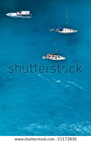 Boats on sea - top view with a lot of blue copy space - stock photo