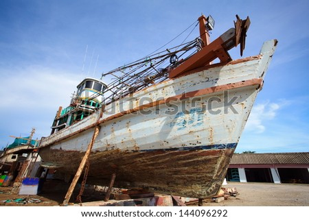 Boats on stands, repair yard - stock photo