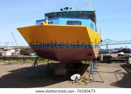 Boats on stands, repair yard Astoria OR. - stock photo