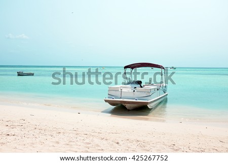 Boats on the beach at Palm Beach on Aruba island in the Caribbean - stock photo