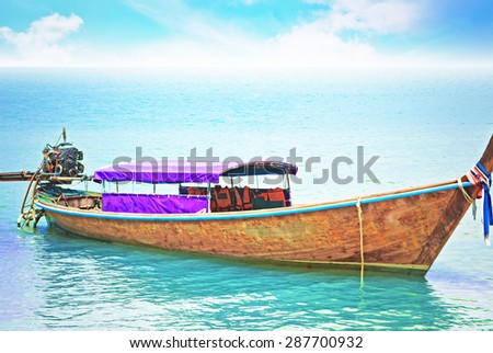 Boats on the beach with blue sky - stock photo
