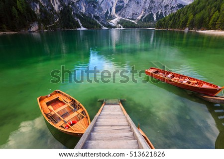 Boats on the Braies Lake ( Pragser Wildsee ) in Dolomites mountains, Sudtirol, Italy