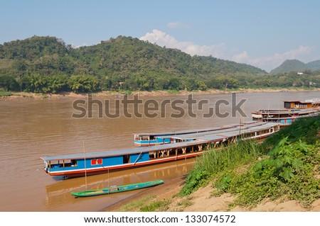 Boats on the Mekong river in Luang Prabang. Laos. - stock photo