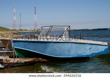 Boats on the shore of Lake Baikal on a sunny day - stock photo