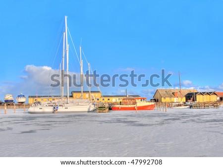 Boats stuck in the ice in Kalvehave Denmark - stock photo
