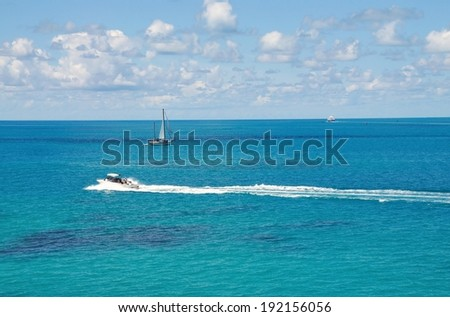 Boats traverse the blue waters of the tropical island of Bermuda