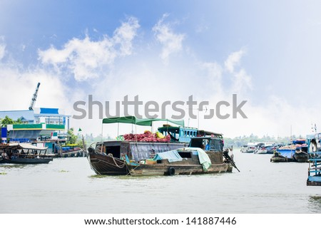 Boats with fruits and vegetables in Cai Be floating market - stock photo