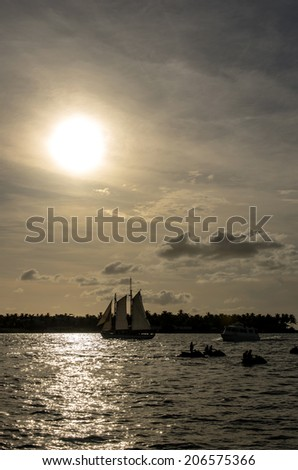 Boats with sunset - stock photo
