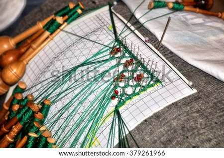 Bobbin lace is a lace worked on a pillow, traditional handcraft