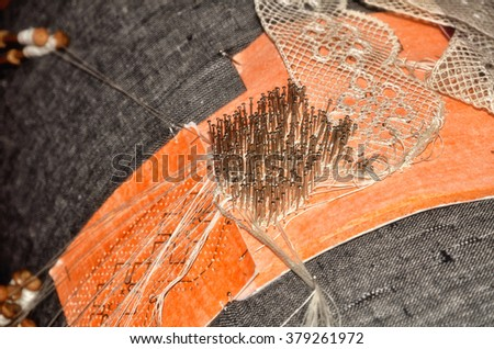 Bobbin lace is a lace worked on a pillow, traditional handcraft - stock photo