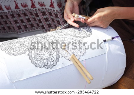 bobbin lace making outdoors closeup - stock photo