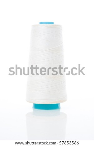 Bobbin of white thread isolated on white background with reflection. - stock photo
