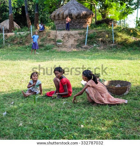 Bodh gaya, Bihar, India . 20 Oct 2015.  A group of young children , weed grasses.  - stock photo