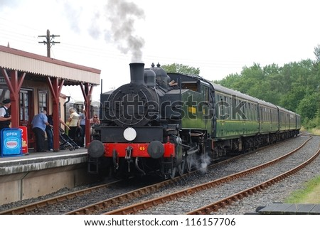 BODIAM, ENGLAND - AUGUST 20: USA 0-6-0T class steam locomotive on the Kent and East Sussex Railway on August 20, 2012 at Bodiam, Sussex. Built in the USA in 1943, it is now in Southern Railway livery. - stock photo