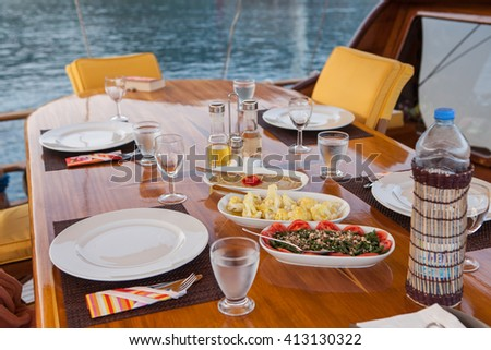 BODRUM, TURKEY, AUGUST 2015, Turkish appetisers on a table set for four people, on a sailing yacht.