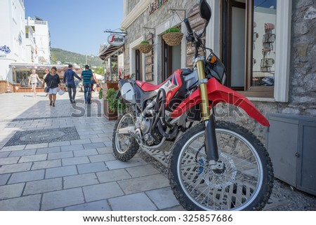 Bodrum, Turkey - 01 Jul 2015: A red Honda motorcylcle was parking at side of a street in downtown area of Bodrum.