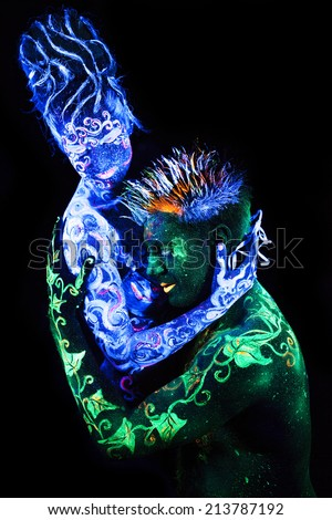 Body art glowing in ultraviolet light,  four elements, Land Loves Air - stock photo