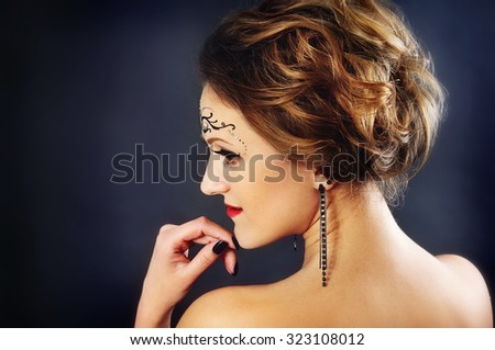 Body art on the face of the girl portrait in the studio - stock photo