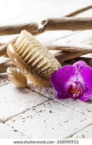 body brush at the beauty spa for purity - stock photo