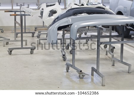 Body car spare part on rack in garage - stock photo