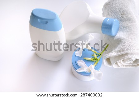 body care and beauty products in white and blue containers on a white table glass in a bathroom top view. Isolated.