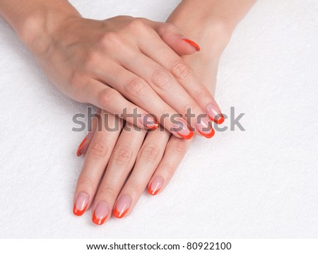 Body care: Hands with french manicure lying down - stock photo