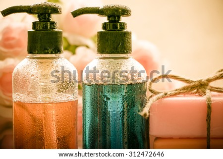 Body care product,shower,shampoo,soap on vintage tone with water drop - stock photo