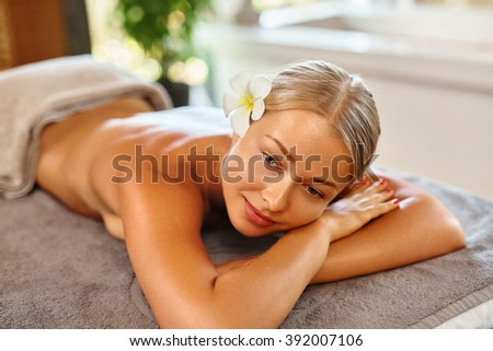 Body Care. Spa Woman. Beauty Treatment Concept. Beautiful Healthy Caucasian Girl Relaxing On Massage Table Before Hand Massage On Relaxed Back In Health And Spa Salon. Skin Care, Wellness, Lifestyle