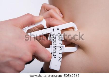 Body fat measurement - stock photo