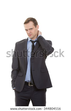body language. man dressed business suit isolated on white background. rubbing his neck. aching, hand in pocket - stock photo