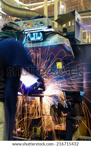Body movement during welding work on skills (production). - stock photo