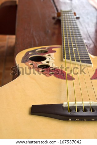 Body of an acoustic guitar close up - stock photo
