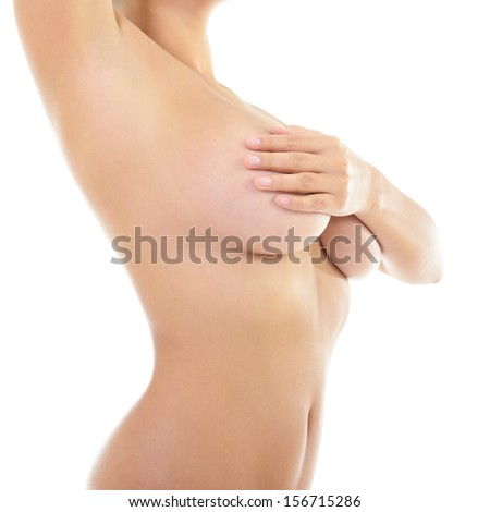 Body of beautiful woman covering her breast and showing armpit, over white - stock photo