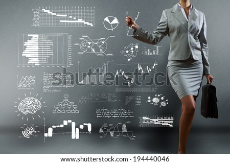 Body of businesswoman drawing business strategy sketches - stock photo