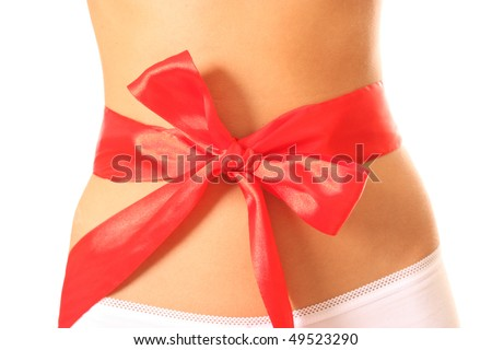 Body of the young harmonous woman with red bow