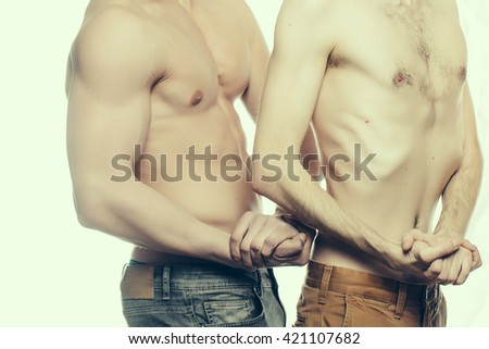 Body of two men with sporty athletic muscular sexy and thin male torso in studio isolated on white background - stock photo