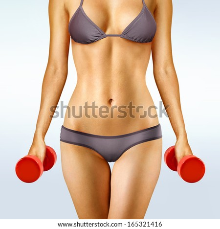 body of woman that working out with red dumbbells - stock photo