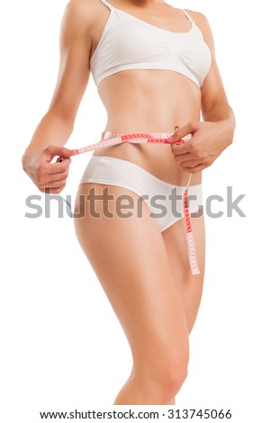 Body of woman with a measuring tape.