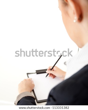 body part of writing businesswoman with clippboard and pen, white background - stock photo