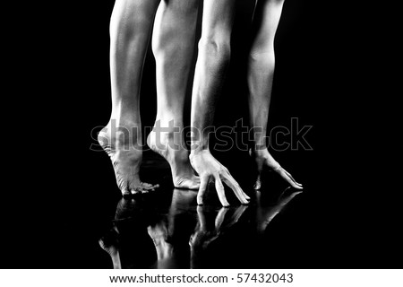 Body parts. Hand and Legs.  On black background. - stock photo