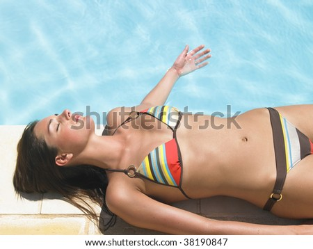 body parts of woman in black bikini - stock photo