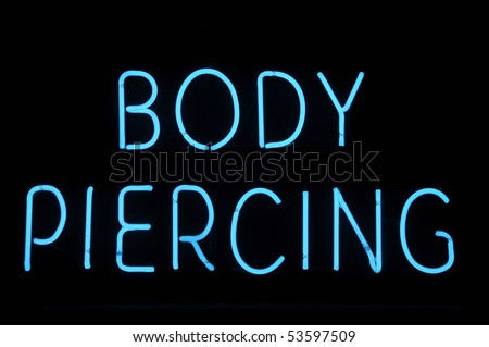 Body Piercing Neon Blue Sign - stock photo