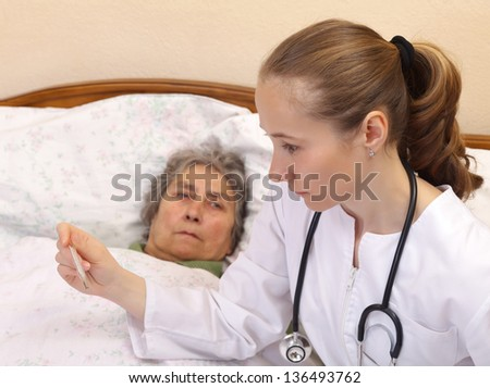 Body temperature measurement for monitoring whether a person is ill - stock photo