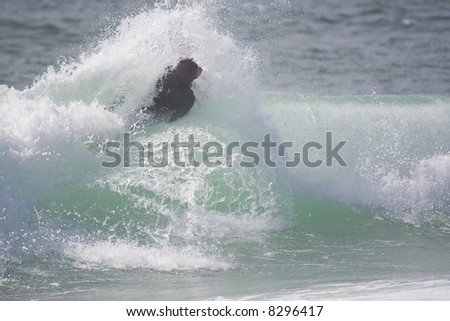 bodyboarder on top of the wave