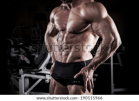bodybuilder at the gym - stock photo