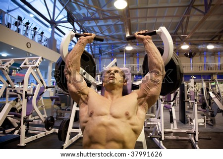 bodybuilder doing weightlifting in gym - stock photo