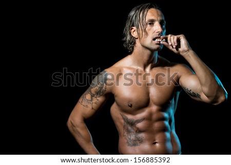 Bodybuilder Eating Chocolate - stock photo