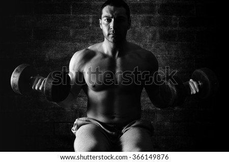 Bodybuilder exercise with barbell .Black and white.