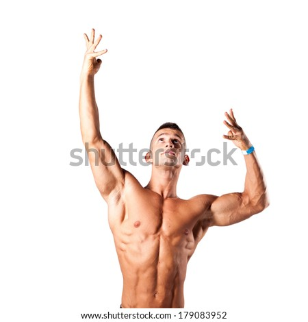 bodybuilder flexing his muscles in studio - stock photo