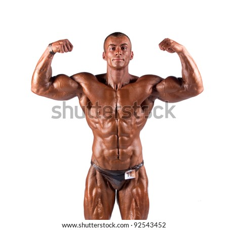 bodybuilder flexing his muscles in studio